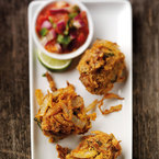 Onion bhajis with roasted tomato chutney