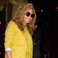 Ooh la la Beyonce! Singer makes fashion statement in yellow suit and Prada flame shoes