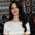 Lana Del Rey shows off new raven coloured waves at GQ Awards 2012