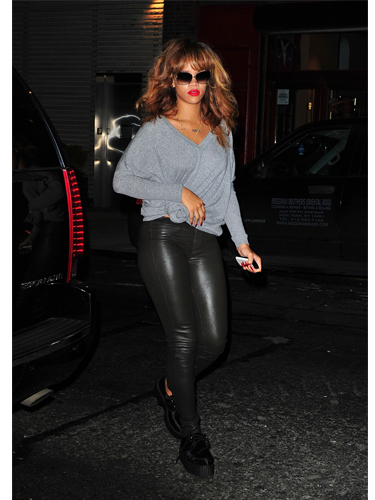 Rihanna wears leather trousers