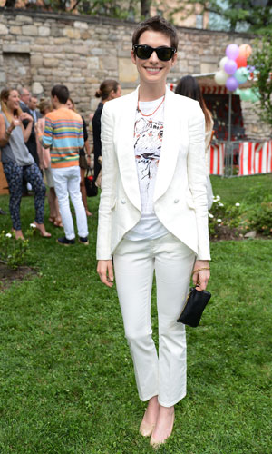Anne Hathaway in white at Stella Mccartney garden party