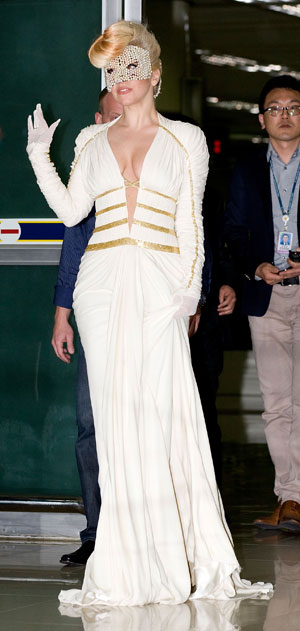 Lady Gaga does airport-chic in couture gown