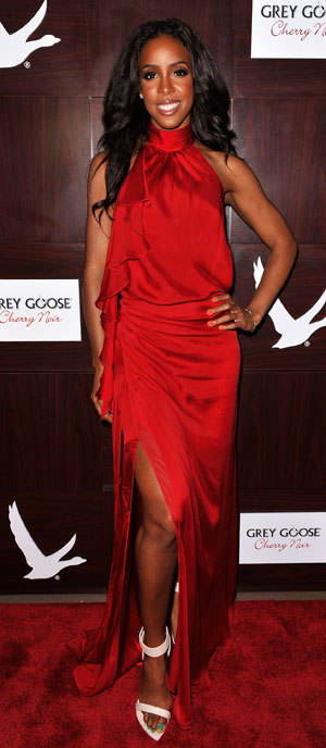 Kelly Rowland in a high necked dress