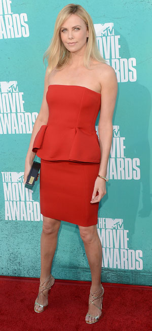 Charlize Theron in a peplum dress