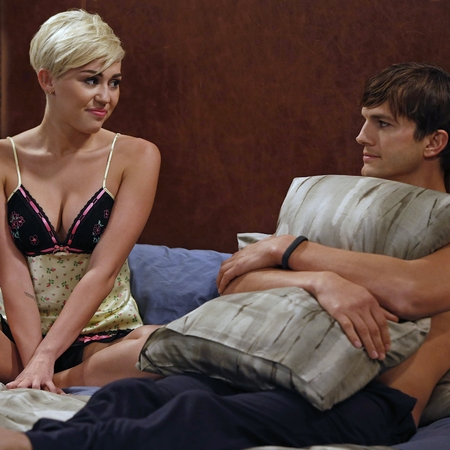 Miley Cyrus and Ashton Kutcher in Two and A Half Men