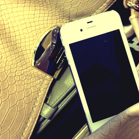 mobile phone in handbag