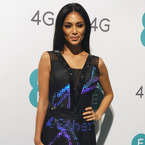 Nicole Scherzinger rocks the Twitter dress