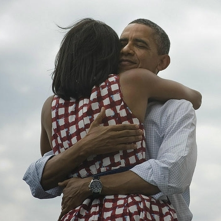 Barack Obama and Michelle Obama hug