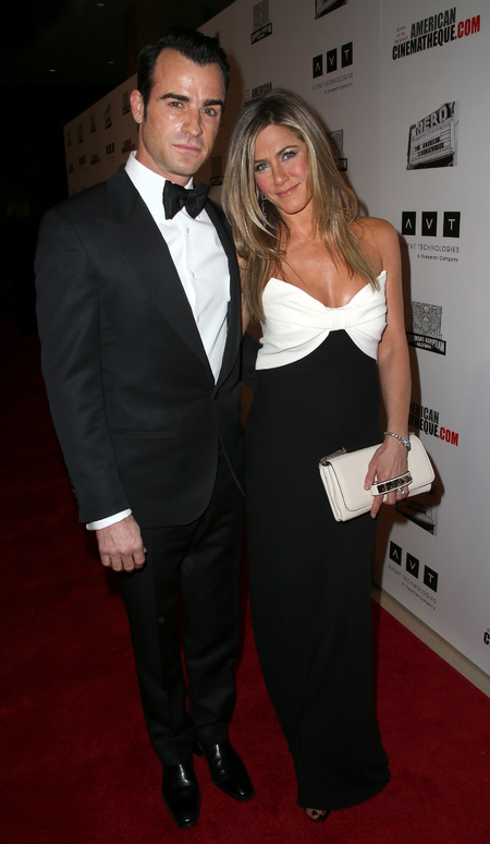 Jennifer Aniston beams in monochrome Valentino gown