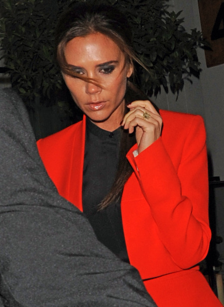 Victoria Beckham suits up in double tangerine for Valentino dinner