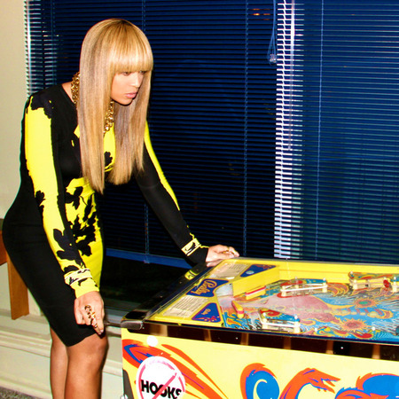 Beyonce plays arcade games in style