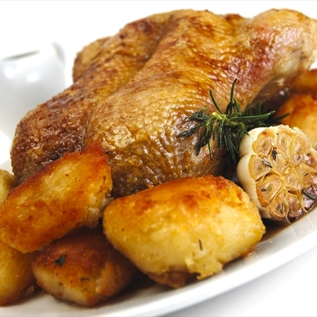 Roast Gressingham Duck with honey and rosemary jus with roast potatoes