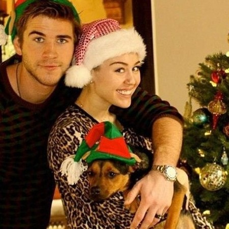 Miley Cyrus's Christmas Card - Bare Breasts and Fat Tongue: Looks Like A Cheap Adult Film Poster (Photos)