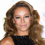 Mel B kisses herself in new video