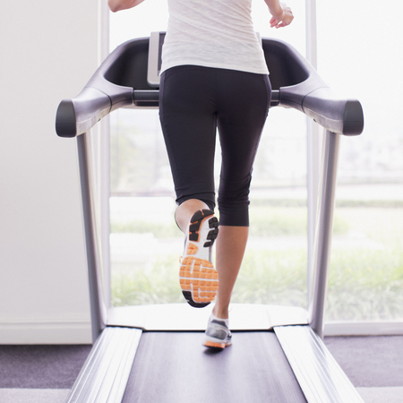 Woman working out on a treadmill - gym workout - fitness plan - running - exercise - diet and fitness - life - handbag.com