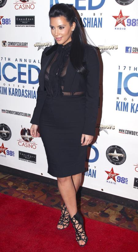 Kim Kardashian does peek-a-boo pregnancy style