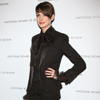 Anne Hathaway works the tux trend in Saint Laurent
