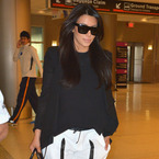 Pregnant Kim Kardashian does Helmut Lang comfort for flight