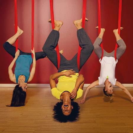 vertical yoga working out with friends