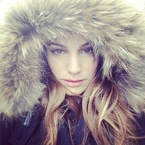 Kelly Brook wraps up for winter snow