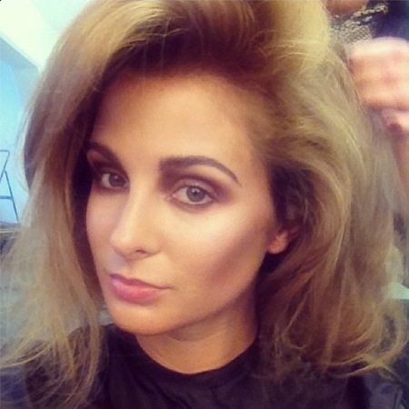 Millie Mackintosh works dramatic make-up for new shoot