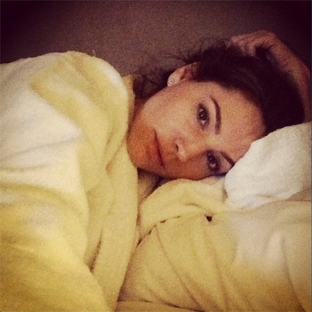 Kelly Brook does a Victoria Beckham in fresh white robe