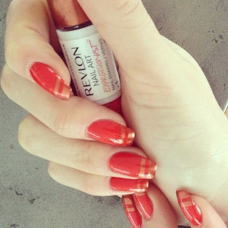 Jessie J red and orange striped Revlon nail art