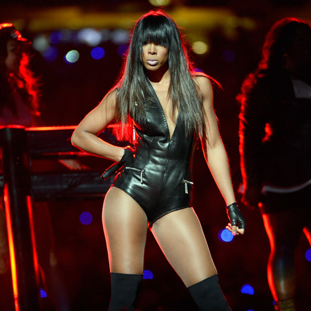 Kelly Rowland dons Emilio Pucci leather leotard for Super Bowl special