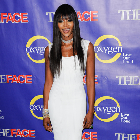 Naomi Campbell works white fishtail gown for The Face premiere