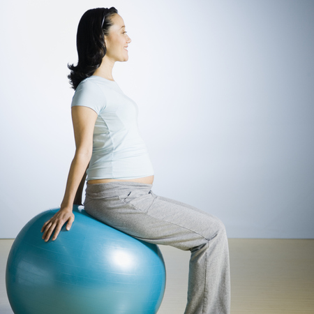 Pregnant woman with exercise ball