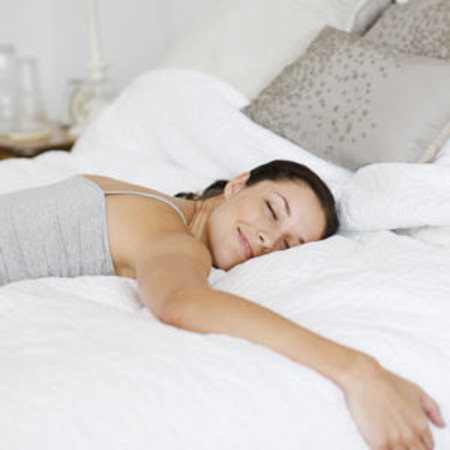 Woman sleeping happy in bed