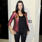 Liberty Ross shimmers in metallic blazer for Tom Ford cocktails