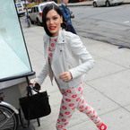 Jessie J styles up floral onesie with white biker jacket
