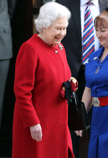 Queen Elizabeth leaves hospital in rich red hues
