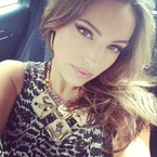 Kelly Brook works fierce eye make-up for Celebrity Juice