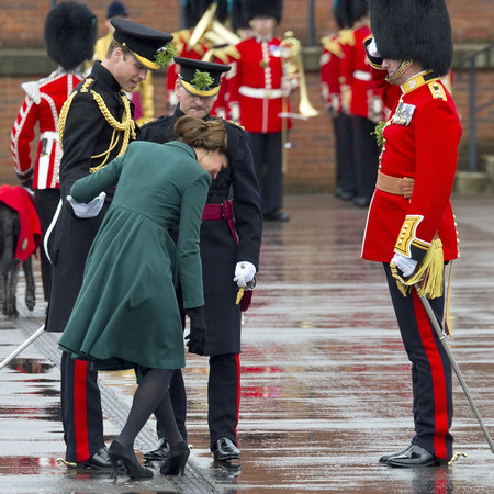 Kate Middleton tries to free her heel from the drain