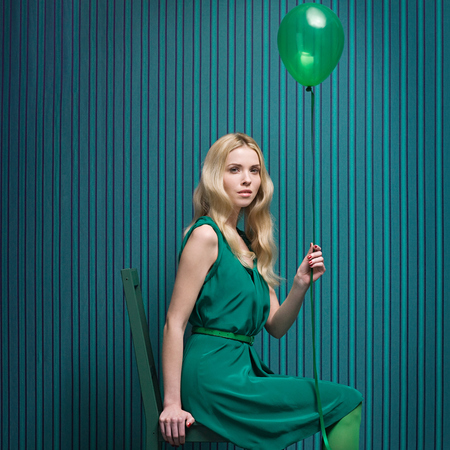 Girl in green with balloon