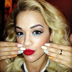 Rita Ora shows off bright and bold stage makeup