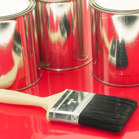 Paint brushes and tin