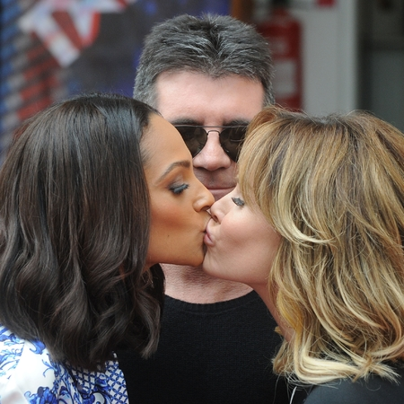 Britain's Got Talent's Simon Cowell watches Amanda Holden & Alesha Dixon kiss