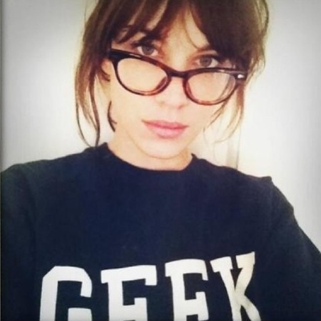Alexa Chung geek glasses and slogan jumper