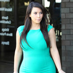 Pregnant Kim Kardashian rocks head-to-toe turquoise