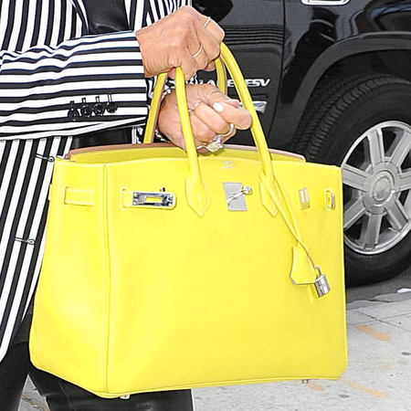Kris Jenner with yellow Birkin Bag