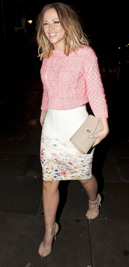 KIMBERLEY WALSH IN DUNE SHOES, PINK OWN THE RUNWAY JUMPER, LAUNER HANDBAG AND FLORAL PENCIL SKIRT