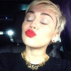 Miley Cyrus pulls a Rihanna with Chanel bling