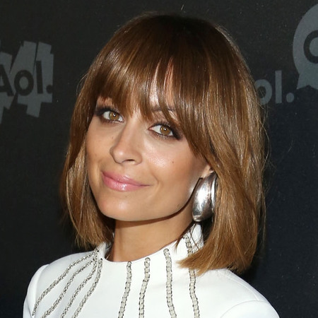 Nicole Richie in white dress with brown bob and fringe