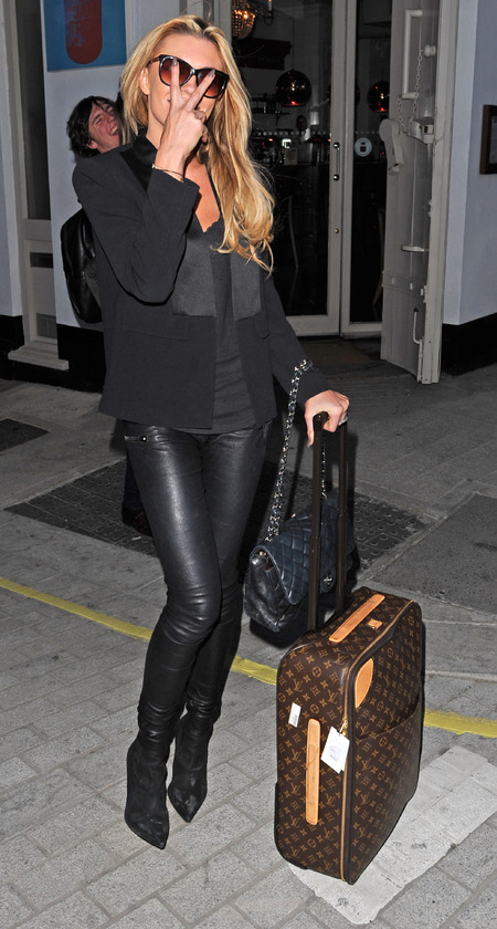 Abbey Clancy with Louis Vuitton suitcase