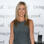 Jennifer Aniston shows off summer pins in little grey dress