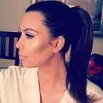 Kim Kardashian shows off sleek high ponytail