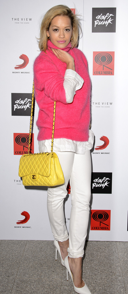 Rita Ora wears 90s roll neck and yellow Chanel bag at Daft Punk album party The Shard